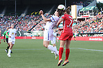 19 June 2015: Kansas City's Amy LePeilbet (left) and Portland's Sinead Farrelly (7) challenge for a header. The Portland Thorns FC hosted FC Kansas City at Providence Park in Portland, Oregon in a National Women's Soccer League 2015 regular season match. The game ended in a 1-1 tie.