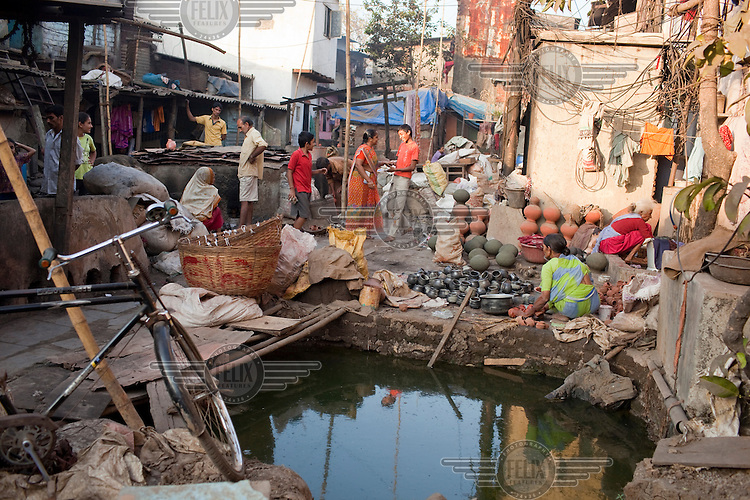 People in the pot manufacturing distrct of Dharavi slum.