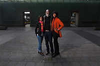 "New York, NY - November 05, 2013 : Veteran Scott Riley with his daughters Hasha Riley, left, and Libra Riley-Johnson, right, at the New York City Vietnam Veterans Memorial Plaza in New York, NY on November 05, 2013. Vet Scott Riley spent 30 years after her came back from Vietnam as a drug addict. Then he got clean and wrote a book--""Grace in the Wilderness"" with his two daughters."