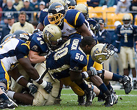 30 September 2006: Pitt defensive lineman Rashaad Duncan (50) loses his helmet while tackling a Toledo ball carrier.  The Pitt Panthers defeated the Toledo Rockets 45-3 on September 30, 2006 at Heinz Field, Pittsburgh, Pennsylvania.