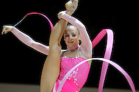 Marina Shpekt of Russia turns pivot with ribbon during All-Around competition at 2006 Thiais Grand Prix in Paris, France on March 25, 2006.  (Photo by Tom Theobald)