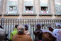 """Nurses looking people """"Hugging"""" the princess hospital against the privatization of the public health in Spain"""
