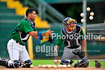 22 June 2009: Vermont Lake Monsters' catchers Sandy Leon (left) and Rick Nolan (right) return balls to the cart after finishing drills prior to facing the Tri-City ValleyCats at Historic Centennial Field in Burlington, Vermont. The Lake Monsters defeated the visiting ValleyCats 5-4 in extra innings. Mandatory Photo Credit: Ed Wolfstein Photo