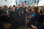 Cardinal Timothy Dolan, the archbishop of New York, greets  people as he enters the church in Inishke, Iraq, on April 10, 2016. Dolan, chair of the Catholic Near East Welfare Association, is in Iraqi Kurdistan with other church leaders to visit with Christians and others displaced by ISIS. They celebrated Mass in the Chaldean Catholic church with local residents and displaced Christians living in local villages.<br /> <br /> CNEWA is a papal agency providing humanitarian and pastoral support to the church and people in the region.