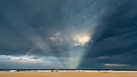 Currumbin, Queensland, Australia.(Saturday, January 23, 2016):  Antisolar Rays - A huge thunderstorm rolled across the southern end of the Gold Coast late this afternoon with lightning and rain. There were spectacular cloud formations as the storm passed by..  Photo: joliphotos.com