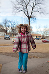 """Kendrick Brinson.LUCEO..Sloan Olson, 3, plays outside her family's apartment in January in oil boom-town Williston, North Dakota. Her grandmother Peggy Adrin said the town has """"really changed a lot"""" since she first moved there 30 years ago. """"When we first moved here, there was nothing,"""" she said. Williston, North Dakota is currently experiencing an influx of people relocating there for the town's third oil boom...Model Released: Yes.Assigning Editor: Michael Wichita."""