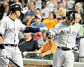 New York Yankees third baseman Alex Rodriguez (13), left, and celebrates with shortstop Derek Jeter (2) after Jeter scored the Yankees final run on a Mark Teixeira sacrifice fly in the eighth inning against the Baltimore Orioles at Oriole Park at Camden Yards in Baltimore, MD on Friday, August 26, 2011.  The Orioles won the game 12 - 5..Credit: Ron Sachs / CNP.(RESTRICTION: NO New York or New Jersey Newspapers or newspapers within a 75 mile radius of New York City)