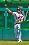 25 July 2013: Washington Nationals outfielder Bryce Harper throws the ball back to the infield during a game against the Pittsburgh Pirates at Nationals Park in Washington, DC. The Nationals salvaged the last game of their series, winning 9-7 ending their 6-game losing streak. Mandatory Credit: Ed Wolfstein Photo *** RAW (NEF) Image File Available ***