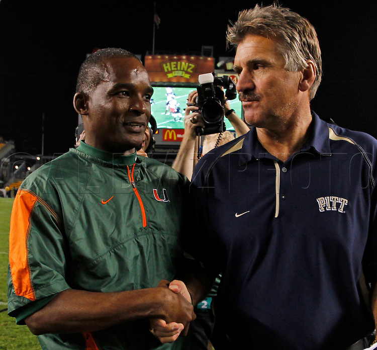Miami's Head Coach Randy Shannon meets at mid-field with Pittsburgh Head Coach Dave Wannstedt during The University of Miami  vs The University of Pittsburgh Panthers at Heinz Field in Pittsburgh, PA, on Thursday, September 23, 2010.