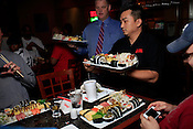 Here come the boats! Sushi Challenge at Kanki Japanese House of Steaks and Sushi, Durham, NC, March 19, 2012.