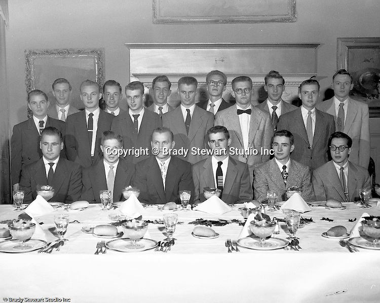 Pittsburgh PA:  View of the Caddies receiving college scholarships from the Western Pennsylvania Golf Association's Caddie Welfare Foundation for year 1953.  The Foundation was managed by Fidelity Trust Company and scholarships are agreed upon by the WPGA executive committee. This dinner was held at the University Club in Pittsburgh and the assignment was for Charles K. Robinson. The mission of the WPGA are to sanction championships, establish handicapping and rate area golf courses.