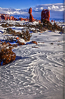 Snow patterns at Balanced Rock  Arches National Park,  Utah   After heavy snow   La Sal Mountains beyond Entrada Sandstone