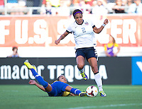 Sydney Leroux (2) of the USWNT steps away from the tackle of Rilany (2) of Brazil during an international friendly at the Florida Citrus Bowl in Orlando, FL.  The USWNT defeated Brazil, 4-1.