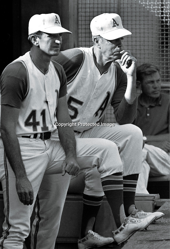OAKLAND A's Manager John McNamara with his coack Joe DiMaggio (1969 photo by Ron Riesterer)