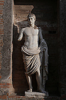 Emperor Nero (37-68AD), plaster cast, Macellum, Pompeii, Italy. The original statue portraying the Emperor Nero as a young man, is now situated in National Museum of Naples. The Macellum, 2nd century BC, Pompeii's covered food market  on the North East of the Forum, contained an Imperial Shrine demonstrating that the cult developed before the 79AD earthquake. Pompeii was seriously damaged by an earthquake in 62AD and engulfed by Volcanic ash after a major eruption of Mount Vesuvius in August 79AD. It lay almost undisturbed  until archaeologists started to excavate it seriously in the 18th century. Photograph by Manuel Cohen.