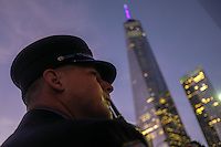 NEW YORK, NY - SEPTEMBER 11, 2016: A New York City firefighter stands near to the Freedom Tower during the 15th anniversary of the 9/11 attacks on September 11, 2016 in New York. Photo by (VIEWpress/Maite H. Mateo)