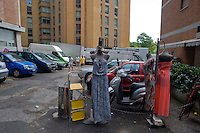 Roma 31 Agosto 2014<br /> Il mercato di Porta Portese in via Ippolito Nievo. Vestiti  esposti per la vendita