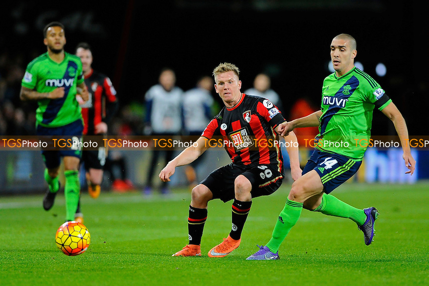 Matt Ritchie of AFC Bournemouth (m) and Oriel Romeu of Southampton watch the ball during AFC Bournemouth vs Southampton, Barclays Premier League Football at the Vitality Stadium, Bournemouth