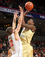 Jan. 22, 2011; Charlottesville, VA, USA; Georgia Tech Yellow Jackets guard Iman Shumpert (1) shoots over Virginia Cavaliers guard Joe Harris (12) during the game at the John Paul Jones Arena. Mandatory Credit: Andrew Shurtleff-US PRESSWIRE
