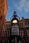 Bankers are Wankers poster outside the Amsterdam Stock Exchange, site of the Occupy Amsterdam demonstration at Beursplein, Amsterdam, the Netherlands. This is one of many 'occupy' protests fallowing the Occupy Wall Street protests in New York, against economic inequality. October 19th 2011. Copyright 2011 Dave Walsh, davewalshphoto.com
