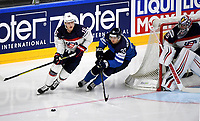 American Jack Eichel (L) skates with the puck under his possession past Finland's Markus Hannikainen during the Ice Hockey World Championship quarter-final match between the US and Final in the Lanxess Arena in Cologne, Germany, 18 May 2017. Photo: Monika Skolimowska/dpa /MediaPunch ***FOR USA ONLY***