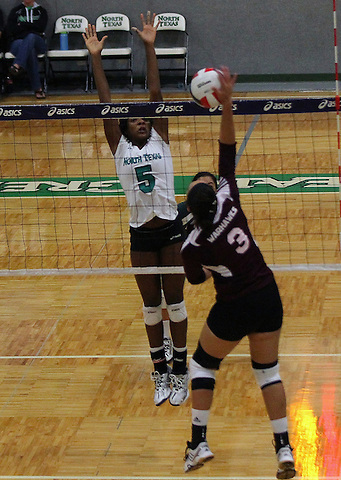 Denton, TX - SEPTEMBER 23: Carnae Dillard #5 of the University of North Texas Mean Green Volleyball blocks a shot against the University of Louisiana at Monroe at University of North Texas Volleyball Complex in Denton on September 23, 2012 in Denton, Texas. (Photo by Rick Yeatts)