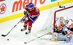 26 October 2009: Montreal Canadiens' left wing forward Guillaume Latendresse sweeps around the opposing net during the third period against the New York Islanders at the Bell Centre in Montreal, Quebec, Canada. The Canadiens defeated the Islanders 3-2 in sudden death overtime for their 4th consecutive win. Mandatory Credit: Ed Wolfstein Photo
