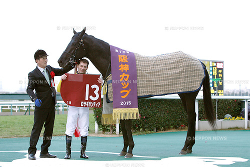 Rosa Gigantea ( Mirco Demuro),<br /> DECEMBER 26, 2015 - Horse Racing :<br /> Jockey Mirco Demuro poses with Rosa Gigantea after winning the Hanshin Cup at Hanshin Racecourse in Hyogo, Japan. (Photo by Eiichi Yamane/AFLO)