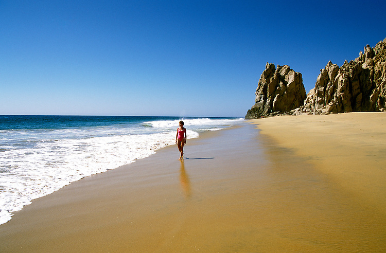 Mexico: Cabo San Lucas.  Woman walking on the beach.  Model released..  Photo #: mxcabo103..Photo copyright Lee Foster, www.fostertravel.com, 510/549-2202, lee@fostertravel.com