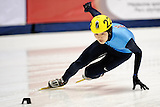 November 5, 2009 - Montreal, CAN - Simon Cho (USA) skates to a first place finish during 500m heat race during ISU Short Track Speed Skating competition.