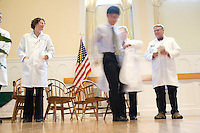 White Coat Ceremony, class of 2015. Beth Kirkpatrick, M.D., left, Jason Hao, Dean Rick Morin, M.D., David Mooney, M.D.