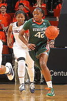 Jan. 6, 2011; Charlottesville, VA, USA; Miami Hurricanes guard Shenise Johnson (42) drives down court in front of Virginia Cavaliers guard Paulisha Kellum (3) during the game at the John Paul Jones Arena.  Mandatory Credit: Andrew Shurtleff-