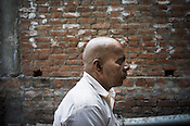 53 year old, Badrinath Singh, father of the rape victim poses for a portrait outside his ancestral house in Medawar Kalan in Ballia district of Uttar Pradesh, India. Photo: Sanjit Das/Panos for Der Spiegel