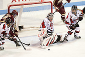Maggie DiMasi (NU - 4), Melissa Bizzari (BC - 4), Chloe Desjardins (NU - 29), Tori Hickel (NU - 55) - The Northeastern University Huskies defeated Boston College Eagles 4-3 to repeat as Beanpot champions on Tuesday, February 12, 2013, at Matthews Arena in Boston, Massachusetts.