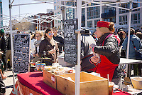 Foodies at the Regal Vegan booth on opening day at the premiere outdoor food court, Smorgasburg in East River State Park in the Williamsburg neighborhood of Brooklyn in New York on Saturday, April 4, 2015. The marketplace features prepared and artisanal foods made in Brooklyn by small entrepreneurs. The market has provided a venue for numerous chefs and cooks to sell their wares, some of whom have grown into large successful businesses. (© Richard B. Levine)