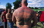 Dutch Roma man with a tattoo of a Gypsy wagon on his back. During the annual Appleby Gypsy Horse fair and festival. Cumbria, England June 1998