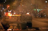 Roma  15 Ottobre 2011.Manifestazione contro la crisi e l'austerità.Scontri tra manifestanti e forze dell'ordine.Cassonetti dati alle fiamme in Piazza Vittorio, sullo sfondo le forze dell'ordine