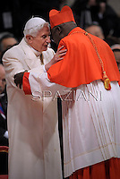 Burkina Faso cardinal Philippe Nakellentuba Ouedraogo    is congratulated by Pope emeritus Benedict XVI  after he was appointed cardinal by the Pope at the consistory in the St. Peter's Basilica at the Vatican on February 22, 2014.