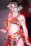 London has its own Burlesque festival. With its origins in nineteenth century music hall entertainments and vaudeville, in the early twentieth century burlesque emerged as a populist blend of satire, performance art, and adult entertainment, that featured strip tease and broad comedy acts that derived their name from the low comedy aspects of the literary genre known as burlesque.....In burlesque, performers, usually female, often create elaborate sets with lush, colorful costumes, mood-appropriate music, and dramatic lighting, and may even include novelty acts, such as fire-breathing or demonstrations of unusual flexibility, to enhance the impact of their performance...
