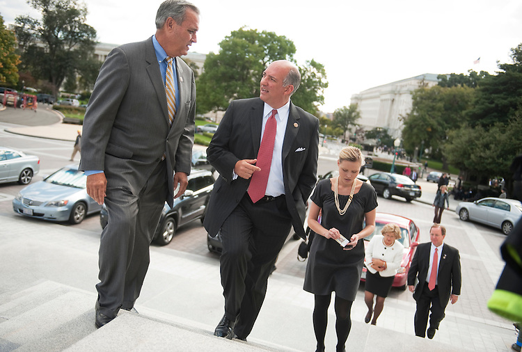 UNITED STATES - OCTOBER 04:  Rep. Steve Southerland, R-Fla., right, talks with Rep. Jeff Miller, R-Fla., on the House steps while en route to a vote on the House floor in the Capitol.  (Photo By Tom Williams/Roll Call)