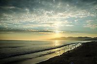 Santa Monica Beach amid the sunset on Thursday, July 11, 2013.