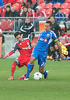 20 October 2012: Montreal Impact midfielder Davy Arnaud #22 and Toronto FC midfielder Eric Avila #8 in action during an MLS game between the Montreal Impact and Toronto FC at BMO Field in Toronto, Ontario..The game ended in a 0-0 draw..