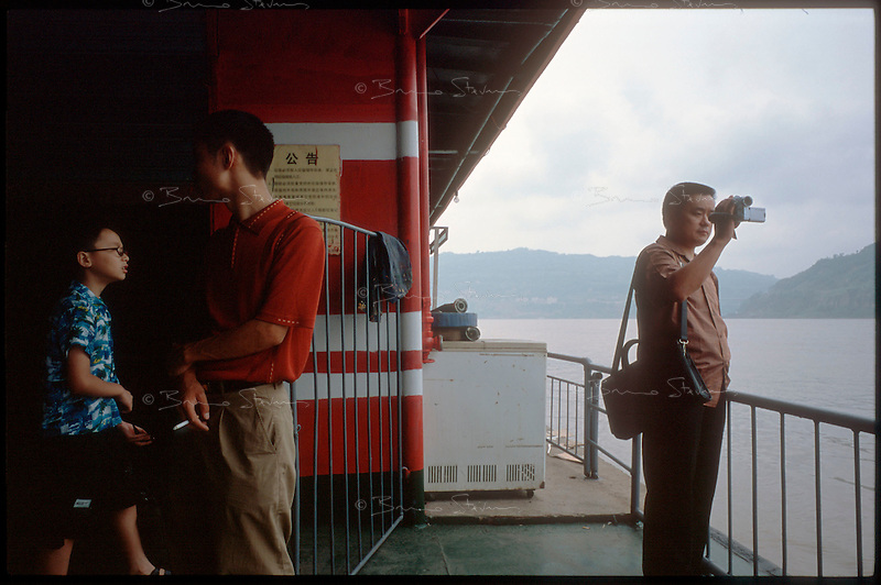 Wangzhou, China, August 2003.A chinese tourist films the Yangtze Kiang river near the entrance of the 3 gorges.