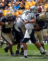 New Hampshire quarterback R.J. Toman is pressured by Pitt defensive lineman Chas Alecxih #98 and Jabaal Sheard. The Pittsburgh Panthers defeat the New Hampshire Wildcats 38-16 at Heinz Field, Pittsburgh Pennsylvania on September 11, 2010.