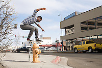 ANCHORAGE, AK - APRIL 2012: Skateboarder Preston Pollard in downtown Anchorge, Alaska.