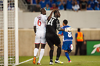 Trinidad and Tobago defender Daniel Cyrus (6) pats goalkeeper Jan Michael Williams (21) on the head during a CONCACAF Gold Cup group B match at Red Bull Arena in Harrison, NJ, on July 8, 2013.