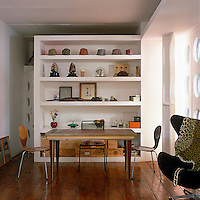 A bookshelf is converted into a huge cabinet of curiosities with a display of eclectic objects