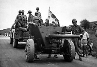 During South Korean evacuation of Suwon Airfield, a 37-mm anti-tank gun is hauled out of the area for repairs, by a weapons carrier.  1950.  INP.  (USIA)<br /> Exact Date Shot Unknown<br /> NARA FILE #:  306-PS-50-9064<br /> WAR &amp; CONFLICT BOOK #:  1387