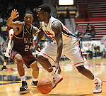 "Mississippi's Nick Williams (20) drives against Arkansas Little Rock's Ben Dillard (24) at the C.M. ""Tad"" Smith Coliseum in Oxford, Miss. on Friday, November 16, 2012. (AP Photo/Oxford Eagle, Bruce Newman)"