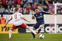 Mike Magee (9) of the Chicago Fire is marked by Dax McCarty (11) of the New York Red Bulls. The New York Red Bulls defeated the Chicago Fire 5-2 during a Major League Soccer (MLS) match at Red Bull Arena in Harrison, NJ, on October 27, 2013.